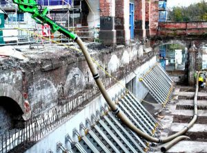 Accessing difficult to reach worksite using extension hoses