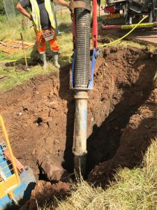 Safely excavating to expose existing pipes