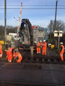 Exposing track for upgrade work at rail crossing