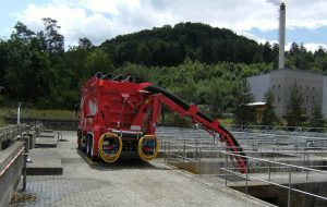 Extracting debris at wastewater treatment facility